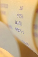 Close-up of numbers on a scroll receipt