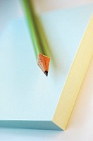 Close-up of a pencil on a notepad