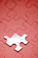 Close-up of an odd piece in a jigsaw puzzle (thumbnail)