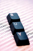 Close-up of the computer keys on financial pages