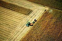 Aerial view of combine harvesting corn, Clinton county, OH