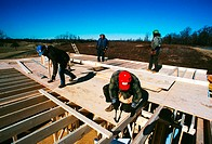 Carpenters working on new home in Prince Georges County , Maryland