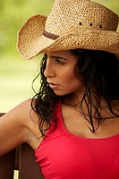 Close-up of a young woman wearing a cowboy hat