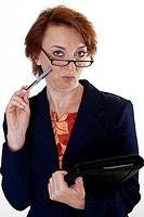 Portrait of a businesswoman holding a pen and a file