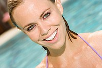 Portrait of a young woman smiling in a swimming pool