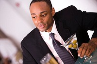 Close-up of a businessman holding a glass of martini