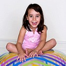 Portrait of a girl sitting on an inflatable ball