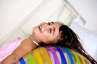 Side profile of a girl lying on an inflatable ball