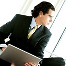 Close-up of a businessman using a laptop (thumbnail)