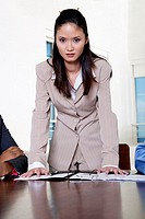 Portrait of a businesswoman leaning forward on a table