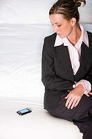 High angle view of a businesswoman looking at a mobile phone