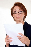 Low angle view of a businesswoman holding a sheet of paper
