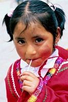 Peruvian girl wearing a traditional costume for a school play. Urubamba, Perù