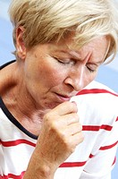 Woman coughing. Sixty year old woman coughing.