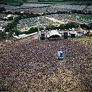 Glastonbury Festival. Crowds surrounding a stage at the Glastonbury Festival of Contemporary Performing Arts. This live music festival has been held e...