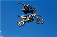 Low angle view of motorcross driver in mid_air jump