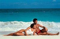 Young couple sunbathing on beach