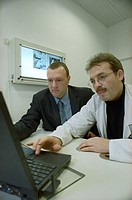 Two doctors using laptop