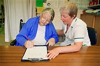 Occupational therapist with patient doing Rey figure copying test, which detects perceptual defects following stroke