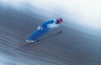Blurred view of person skiing in mid air