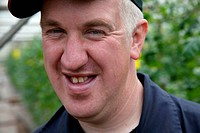 Portrait of man with learning disability smiling, at Brook Farm, Linby,