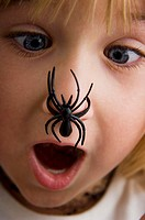 Girl with spider on her nose