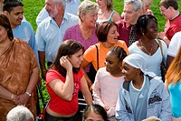 Large multiracial group of people talking and laughing with each other