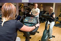 People using upright fitness bike at Southglade Leisure Centre, Nottingham