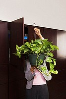 Business woman carrying plant