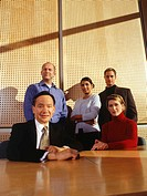Group of business people posing in office, portrait