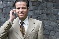 Portrait of a businessman using a mobile phone