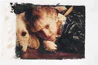 Girl (6-7) with dog lying on floor, close-up