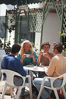 Group of friends in restaurant having coffee, outdoors