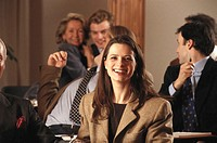 Businesspeople in meeting, woman smiling