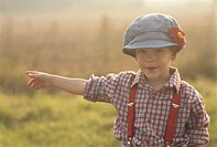 Boy (6-7) in field with arms out
