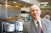 Portrait of a businessman standing in a commercial kitchen