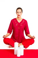 Woman in red meditating