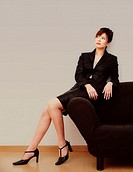 Businesswoman posing on the couch
