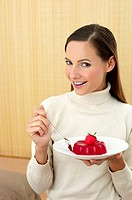Woman holding a plate of strawberry jelly