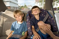 Brothers (4-7) in back seat of car, smiling, portrait