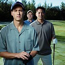 Three golfers standing together