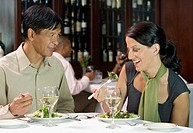Couple eating salad in restaurant
