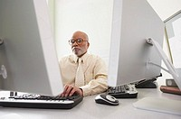 Businessman using computers