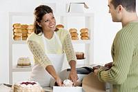 Woman at bakery helping customer