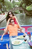 Young couple eating lunch on a boat