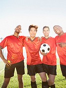 Group portrait of soccer players with ball