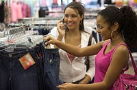 Two teen girls shopping for clothes