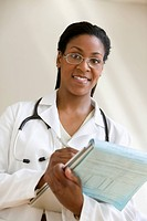 Female African American doctor smiling with clipboard