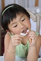 Girl reading Chinese fortune from cookie