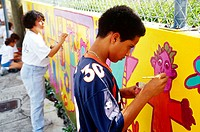 Children painting a mural during Hands On Miami Volunteer Day.